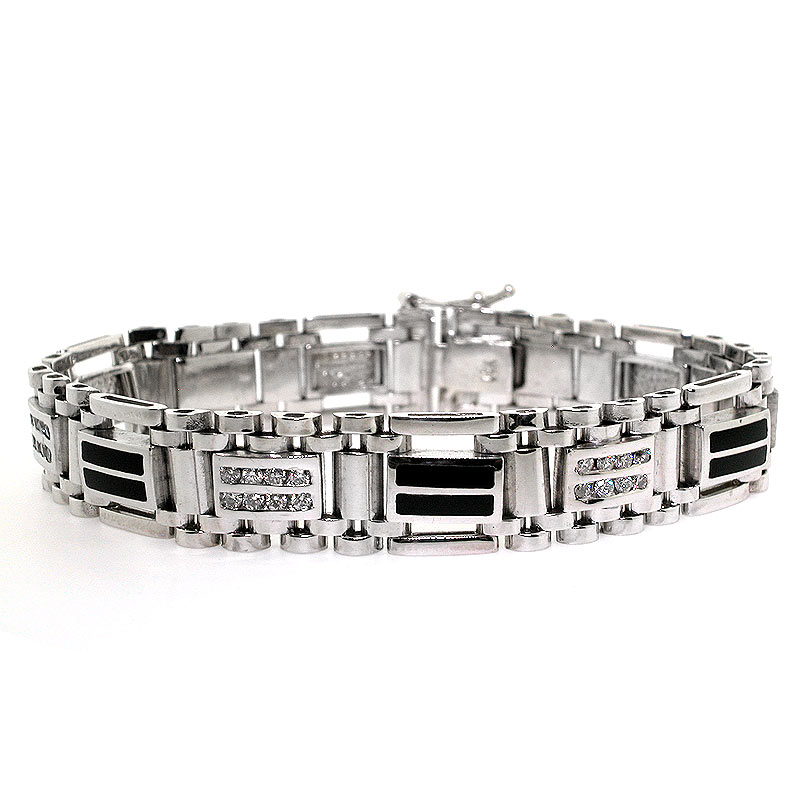 ae7972fab84 This mens diamond bracelet is crafted out of solid 14k white gold and  features round brilliant diamonds and black onyx inlays